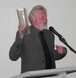 Professor John Carroll receiving his Drama Australia award for excellence in Drama Education at the Turning The Tides conference held in Sydney