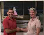 Head of the CSU School of Visual and Performing Arts and judge of the 2009 Casella Art Prize, Associate Professor Margaret Woodward and artist Mr Warren Lane in front of his winning painting The Accidental Activist.