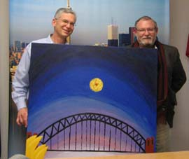 Australian Consul General Stefan Trofimovs (left) and CSU's Professor Rod Francis with a Lianne Lewis work depicting some Australian icons.