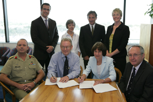 ADF and CSU sign a new postgraduate training agreement in Canberra, including Dean of Faculty of Arts Professor Lyn Gorman (sitting third from left) and lecturer Zoe Hibbert (standing fourth from left)