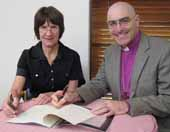 Deputy Vice Chancellor (Administration) Professor Lyn Gorman and  Bishop Stuart Robinson from the Anglican Diocese of Canberra and Goulburn sign the MoU on Monday 21 March.