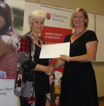 CSU Dean of Education Professor Toni Downes (left) presents an award to Ms Krista Arnold.
