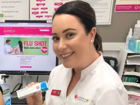 Charles Sturt pharmacy alumna Jenna Cormack at work in her pharmacy