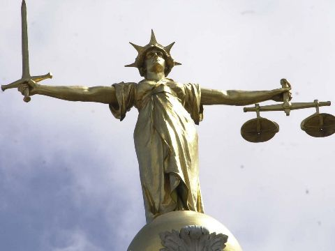 Statue of Blind Justice with sword and scales