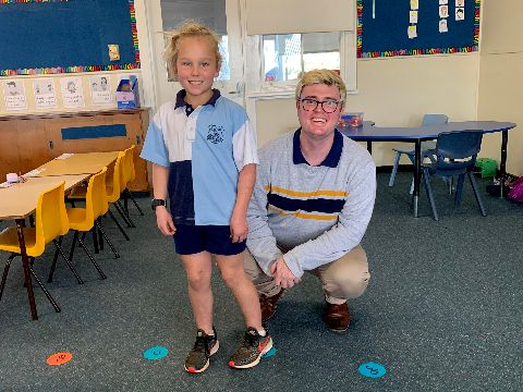 Ed Smith pictured in the classroom with one of his primary school students