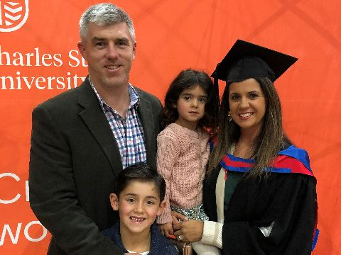 Orange graduate Jenna Hattersley with her husband and two children
