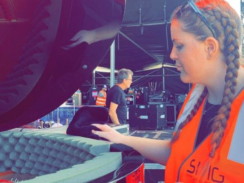 Miss Taylor buffing piano before concert