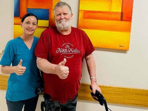 Ms Elise Jenkins and 'GET MOVING' patient Mr Glenn Purcell.