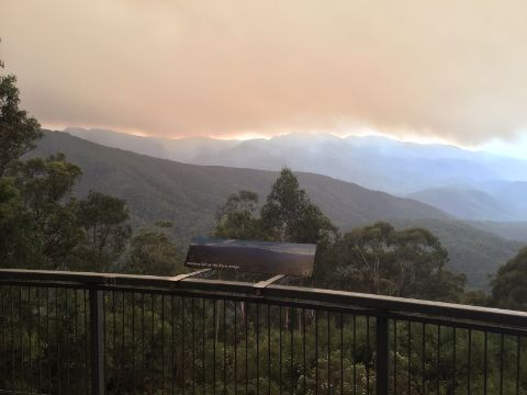 Kosciuszko National Park lookout. Thick smoke rolls east over the main range.