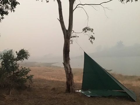 Professor Watson's tent near Lake Jindabyne. Smoke surrounds the tent and lake.